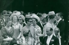 Princess Beatrix standing with group of people.