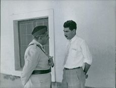 Officers of Iraq having serious conversation. July 31, 1959