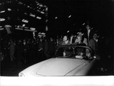 The Gaullist (loyal to de Gaulle) having a demonstration  A woman on the motorcade making a peace sign