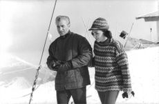 Mohammad Reza Shah Pahlavi and Farah Pahlavi walking on a snow field.
