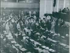 Men gathered in the assembly.  1961