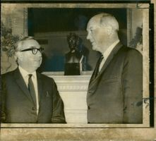 Lord George Brown (L) talking with Mr. Dean Rusk