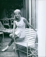 Lois June Nettleton sitting on arm chair, 1967.