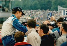 The fans gathered around Rickard Rydell at Brands Hatch for a short chat and an autograph by the Swedish racing driver.