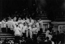 Pope Paul VI coming down the stairs.