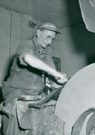K J Erikson's knife factory in Mora. Sven Rondin ensures that the blades get the right edge