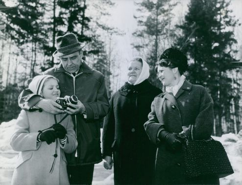 Cosmonaut Vladimir Komarov with his wife , daughter and sister.