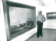 Maritime Museum: the intendent of a large oil painting of ships