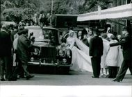 People flock outside to get a glimpse of Prince Edward, Duke of Kent and wife Katharine before riding their wedding car.  - Jun 1961