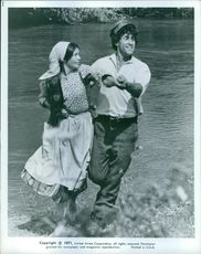 A man and woman in romantic scene from the film Fiddler on the Roof.