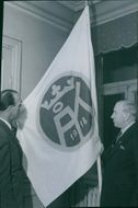 Axel Sundman and Gunnar Lindgren around donated flag at the 30th anniversary of the Åland friends' association. - 24 February 1948