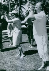 A photograph of people dancing together. 1963.