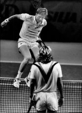 Boris Becker skips the net to thank his opponent, Peter Lundgren, who defeated in the final of the Stockholm Open.