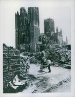 Frenchmen clearing rubble of destroyed houses beside the Church at Periers.