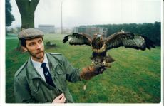 Ian Bedingfield with a Buzzard.