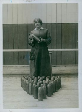 A woman holding a grenade. 1915.