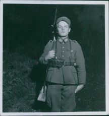 Soldier guarding during wartime.