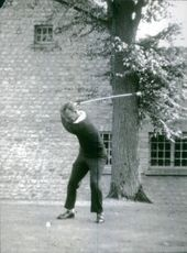 Arnold Palmer pictured playing golf.