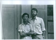 """Sam Waterston and Haing S. Ngor in the scene of the movie, """"Killing Fields"""". 1984"""