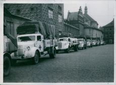 The white Red Cross cars entering the area in front of the castle Hradcany