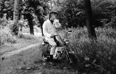 "Robert Francis ""Bobby"" Kennedy sitting on a scooter."