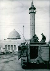 In the shadow of the mosque, Israeli soldiers patrol the street of Khan Yunis in the Gaza Strip, 1988.