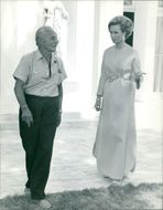 Geneviève Gilles  talking to an old man.