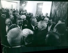 Konrad Adenauer meeting with people.