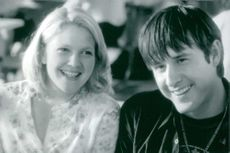 Drew Blythe Barrymore smiling with David Arquette.