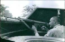 Man holding a riffle, and targeting.