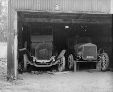Obsolete autos in barns.