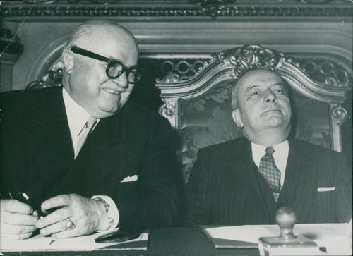 Johannes Hoffman and Georges Bidault sitting together and smiling, 1953.