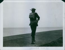 A soldier walking at port with a SCR-300 backpack radio during British Empire.