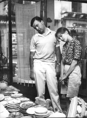 Leslie Caron in a store with a man.