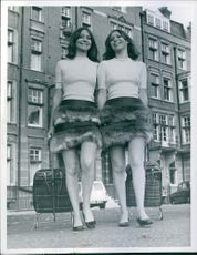 Twins 19 years old models Sar and Ruthlor leaving their home with their luggage bags.