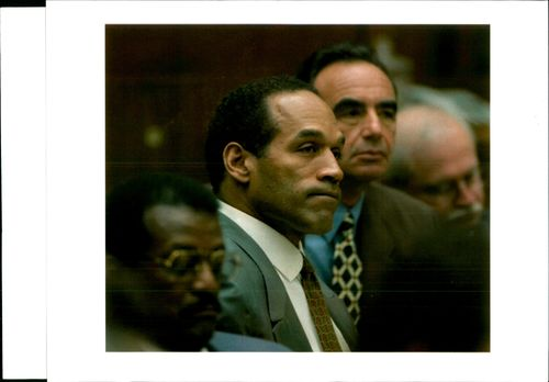 OJ Simpson is joined by part of his defense team.