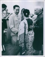 Zhou Enlai shaking hands with unknown woman. 1966.