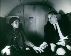 Jacques Chaban-Delmas with a woman in the private plane. 1971