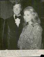 """Roger Moore and his wife Luisa arrive at the premiere of the movie """"Moment 22"""" at the Paramount Theater"""