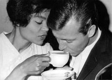 Eartha Mae Kitt with a man.