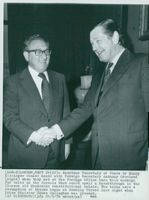 Henry Kissinger shakes hands with Anthony Crosland at their meeting at the Foreign Office
