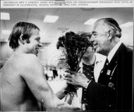 Gunnar Larsson is congratulated by Prince Bertil during the Olympic Games.