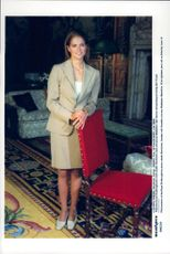 Princess Madeleine poses at a chair at Drottningholm Castle.