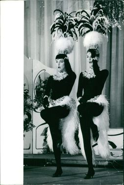 Mia and Pia Genberg, with head dress,  performing.