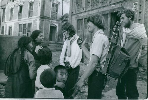 Foreigners talking to natives of Kathmandu in Nepal.  - Mar 1970