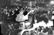 Pope Paul VI riding a Pope mobile while parading.