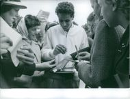 """Pierre Darmon and Rosa """"Rosie"""" Maria Reyes giving autograph to their fans."""