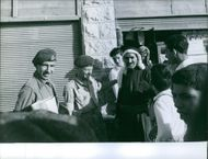 Soldiers standing and talking with people in Lebanon.