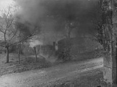 An area full of smoke because of bombing during war between Germany and Russia.  - 1942