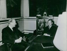 Willy Brandt smiling in a conversation with another person, October 22, 1967.